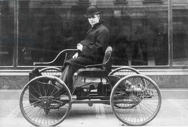 HENRY FORD (1863-1947) American automobile manufacturer. Photographed in 1896 with the first Ford automobile.
