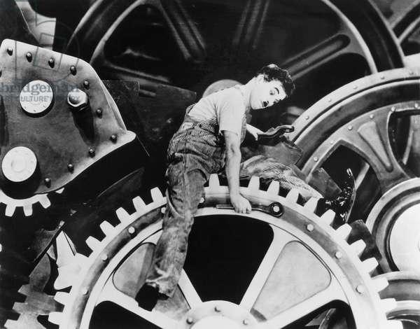 CHAPLIN: MODERN TIMES, 1936 Charlie Chaplin in a scene from the film 'Modern Times,' 1936.