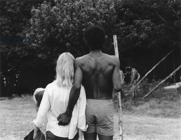 HIPPIE MOVEMENT, 1969 A pair of hippies walk along a path at the Woodstock rock festival in upstate New York.