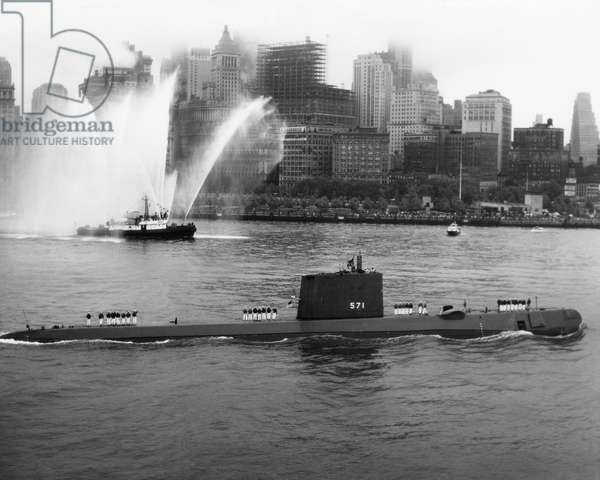 NAVY: USS NAUTILUS, 1958 The crew of the USS Nautilus standing on deck as the submarine enters the New York Harbor. Photograph, 1958.