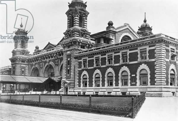 ELLIS ISLAND, c.1920 Partial view of the main building on Ellis Island, the immigration station in New York Harbor, c.1920.