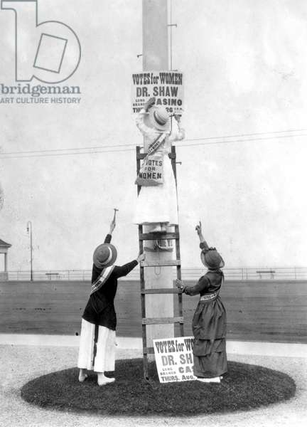 SUFFRAGETTES, 1915 Suffragettes posting advertisements for women's rights events in Long Branch, New Jersey, 1915.