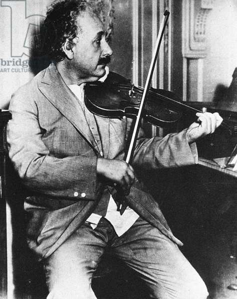 ALBERT EINSTEIN (1879-1955) American (German-born) theoretical physicist. Einstein playing the violin while onboard a ship to the United States in 1930.