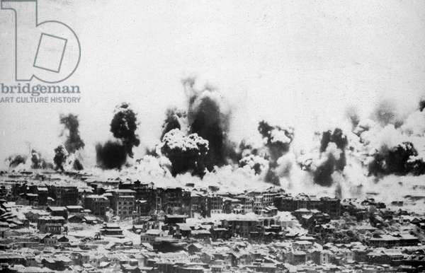 CHUNGKING: BOMBING, 1940. Clouds rise over the city of Chungking as it is bombed by the Japanese during the Second Sino-Japanese War. Photographed 1940.