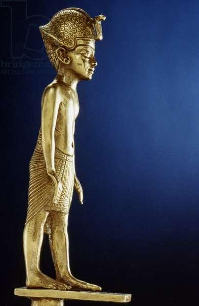 TOMB OF KING TUTANKHAMEN Gold figure of Tutankhamen, c.1342 B.C.