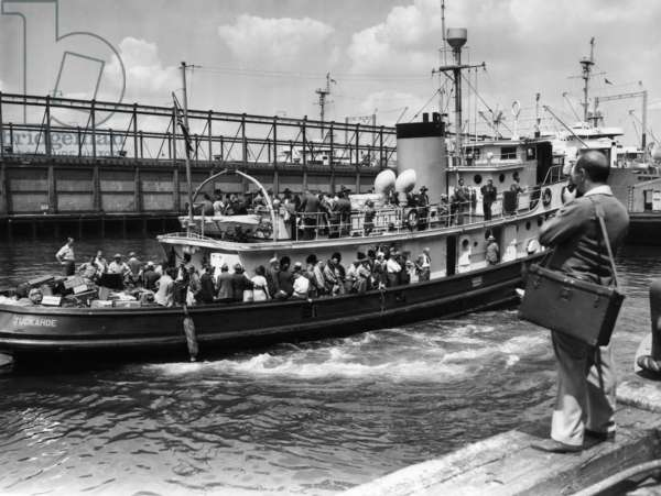DEPORTATION, 1948 Nazis, Germans and Polish deportees aboard a U.S. Army tugboat en route to Europe, possibly leaving from Ellis Island. Photograph, 1948.