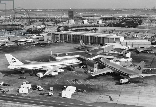 NEW YORK: JFK AIRPORT American Airlines Boeing 747 airplanes at John F. Kennedy airport in New York City. Photograph, 1970s.