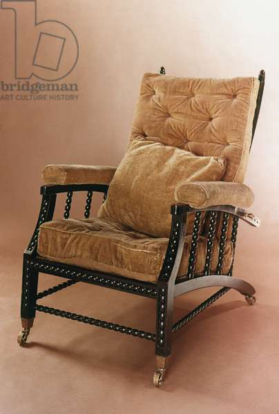 WILLIAM MORRIS: CHAIR 'Morris' adjustable-back armchair designed by William Morris, c.1866.