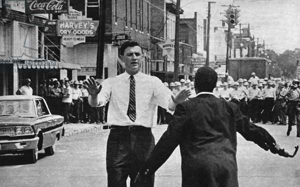 JOHN DOAR (1921- ) American lawyer and politician. Doar, as first assistant in the Civil Rights Division, pleading with an African American demonstrator in Jackson, Mississippi, 1963.