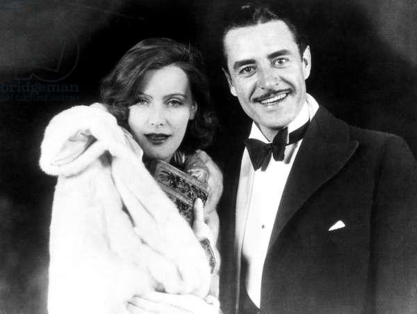 GARBO AND GILBERT, 1927 Greta Garbo and John Gilbert enjoying Hollywood night life, c.1927.