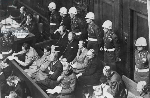 NUREMBERG TRIALS (1945-1946) The defendents (front row, L-R): Hermann Goering, Rudolf Hess, Joachim von Ribbentrop, and Wilhelm Keitel. (Back row, L-R): Karl Doenitz, Roeder, Baldur von Schirach, Fritz Sauckel, and Alfred Jodl. Photograph, 1945-46.