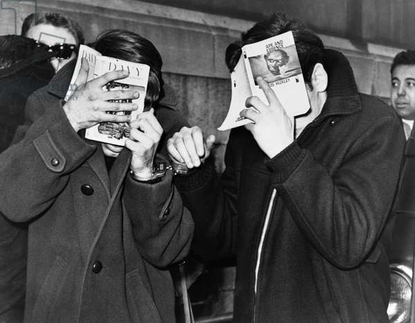 NEW YORK: ARREST, 1968 Two college students covering their faces at the police station, after they were arrested for narcotics. Photograph by Herman Hilly, 1968.
