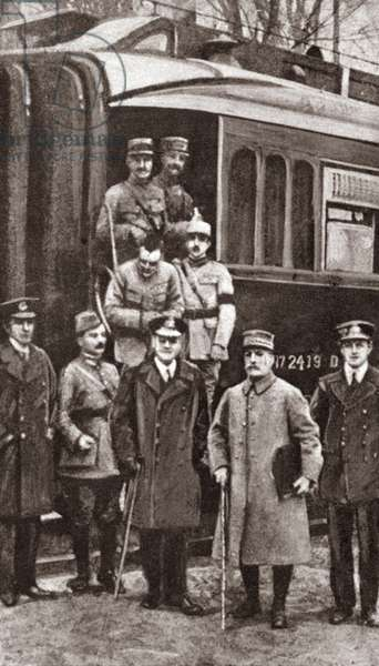 ARMISTICE, 1918 Marshal Foch carrying the signed Armistice preparing to take the train to Paris, France. Photograph, 1918.
