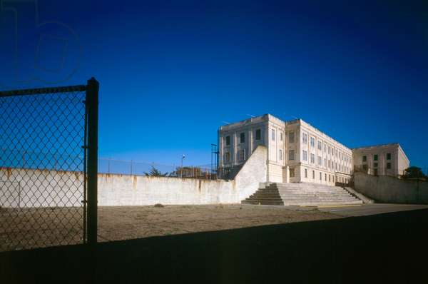 ALCATRAZ, c.1980 Northern facade of the Alcatraz Federal Penitentiary cellhouse, viewed from across the recreation yard. Photograph by Jet Lowe, c.1980.
