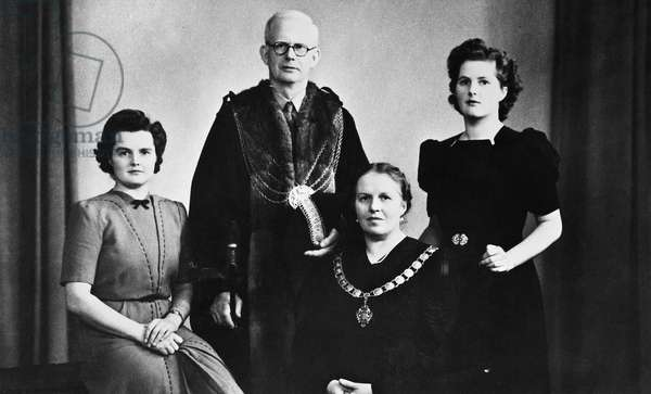 MARGARET THATCHER (1925-2013). English politician. Thatcher (far right) photographed with her parents and sister Muriel, 1945.