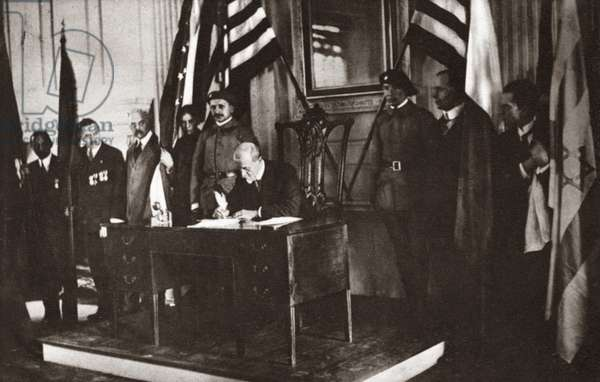 WORLD WAR I: INDEPENDENCE Professor T.G. Masaryk signing the Declaration of Independence of all oppressed nationalities in Independence Hall, Philadelphia, Pennsylvania. Photograph, 1918.