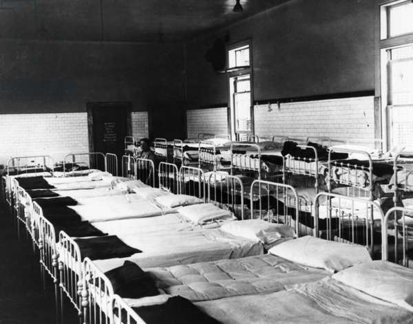 ELLIS ISLAND: DORMITORY Sleeping quarters for immigrants awaiting approval at Ellis Island. Photograph, 1923.
