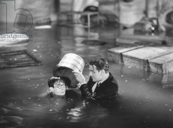 HAROLD LLOYD (1889-1971) American comedian. Lloyd in a still from the film 'Movie Crazy,' 1932.
