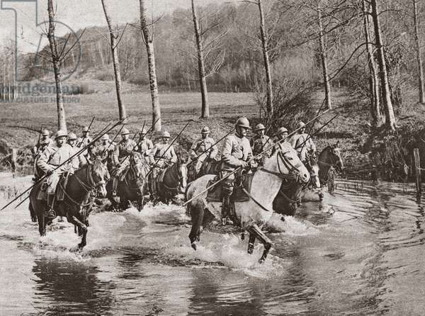 WORLD WAR I: CAVALRY French cavalrymen wading their horses through a stream in pursuit of the retreating German army after the First or Second Battle of the Marne, 1914 or 1918. Photograph.