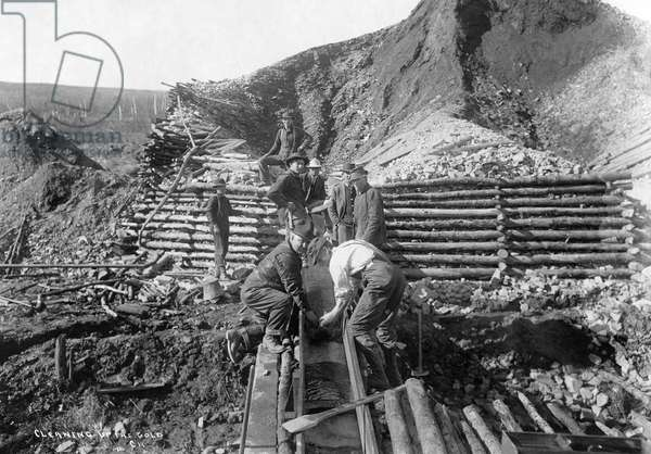 ALASKA: MINING, 1916 Men washing gold in Alaska. Photograph, 1916.