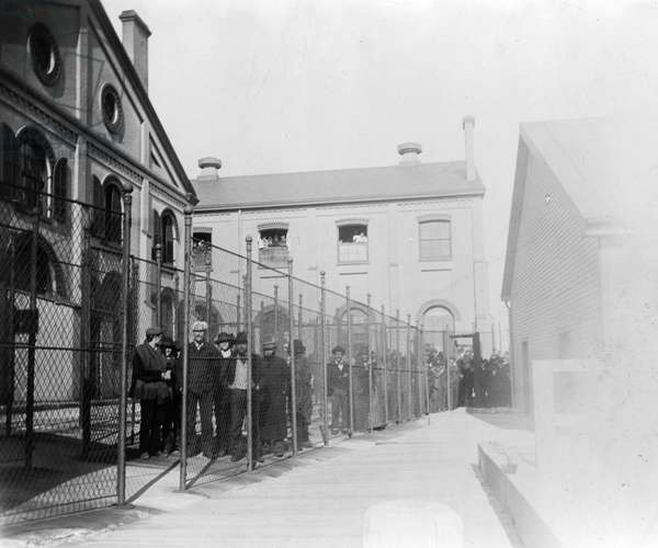 NEW YORK: HOFFMAN ISLAND Immigrants arriving in New York, thought to be infected with smallpox, are held in quarantine on Hoffman Island before arriving at Ellis Island. Photograph, c.1901.