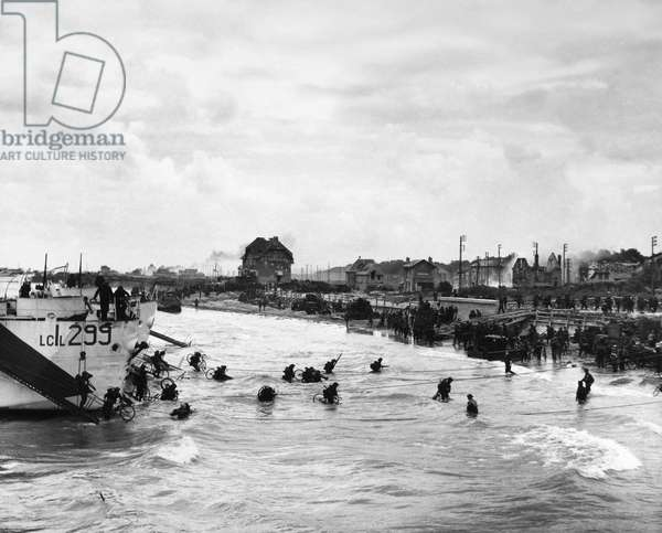 WORLD WAR II: D-DAY, 1944 Canadian troops wading ashore with bicycles during the invasion of Normandy, 6 June 1944.
