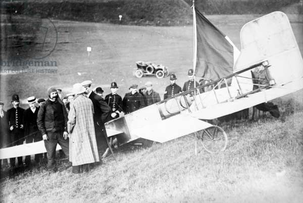 LOUIS BLERIOT (1872-1936) French engineer and pioneer aviator. Bleriot, at left in his flying suit, at Dover, England, after completing the first cross-Channel flight on 25 July 1909.