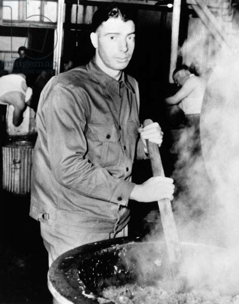 JOE DIMAGGIO (1914-1999) American baseball player. Photographed at work during World War II, c.1943.