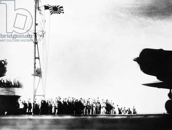 WORLD WAR II: PEARL HARBOR Crewmen on a Japanese carrier cheer as their aircraft take off to attack Pearl Harbor on 7 December 1941.