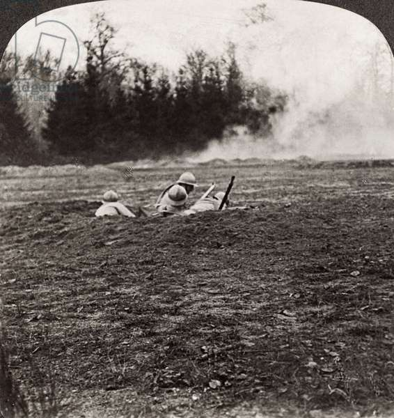 WORLD WAR I: MARNE, 1918 French soldiers in a shell hole behind a smoke screen at the Second Battle of the Marne. Stereograph, 1918.