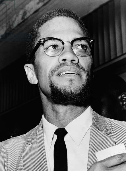 MALCOLM X (1925-1965) Born Malcolm Little. American religious and political leader. Photographed at Queens Court by Herman Hiller, 1964.