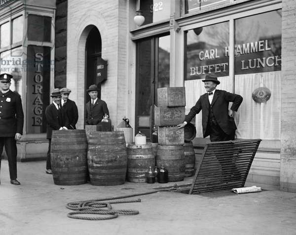 LIQUOR RAID, 1923 Prohibition officers with beer and wine recovered during a raid of Carl Hammel's restaurant in Washington, D.C. Photograph, 25 April 1923.