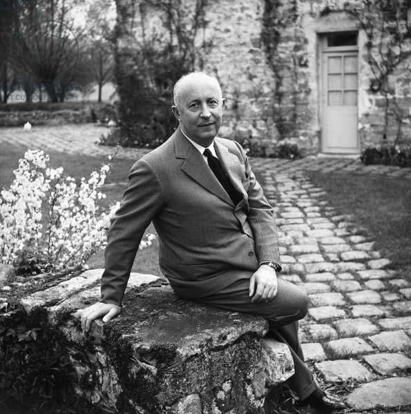 CHRISTIAN DIOR (1905-1957) French fashion designer. Photograph, c.1950.