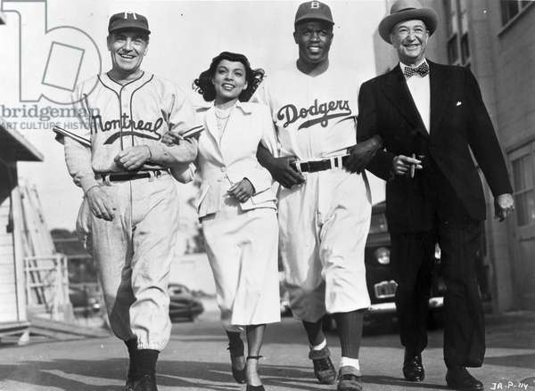 JACKIE ROBINSON (1919-1972) American baseball player. Film still from 'The Jackie Robinson Story' with Richard Lane, Ruby Dee, and Billy Wayne. Photograph, c.1950.