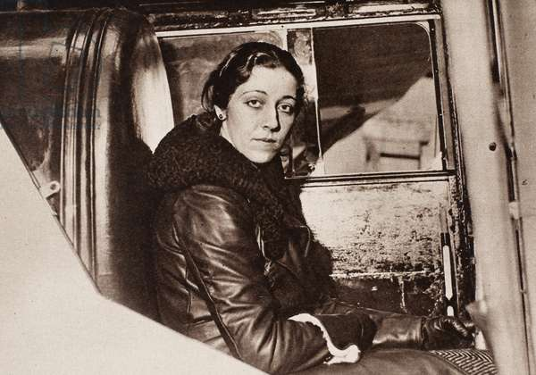 AMY JOHNSON (1903-1941) English aviator. Photographed at the controls of her airplane at the time of her 1932 flight to Cape Town.