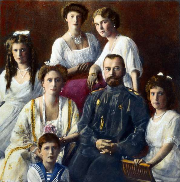 CZAR NICHOLAS II OF RUSSIA (1868-1918). With his family in 1910. Oil over a photograph.