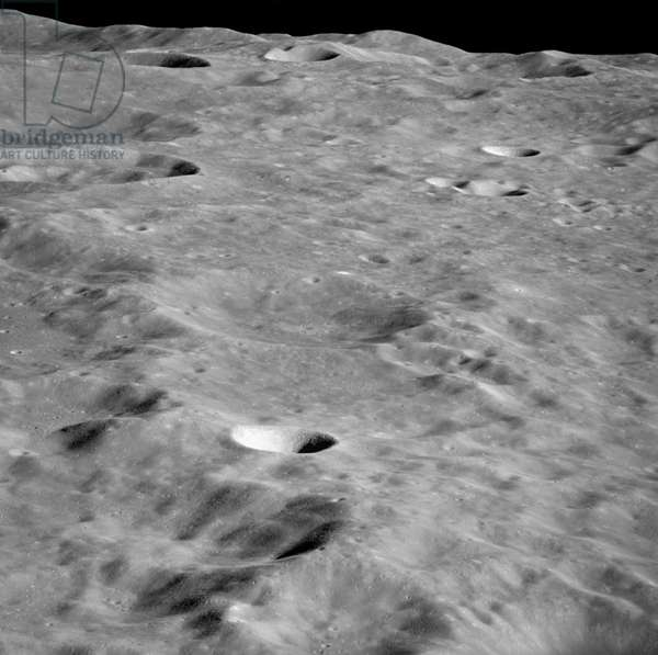 APOLLO 10: MOON, 1969 The far side of the moon in the vicinity of International Astronomical Union crater No. 300, as seen from the Apollo 10 Command and Service Module. Photograph, May 1969.