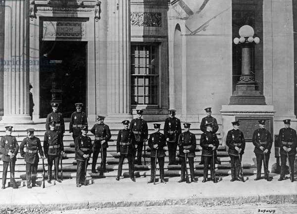 SACCO & VANZETTI, 1927 Riot squad guards outside of the courthouse in Dedham, Massachusetts, during the trial of Italian anarchists Nicola Sacco and Bartolomeo Vanzetti. Photograph, 1927.