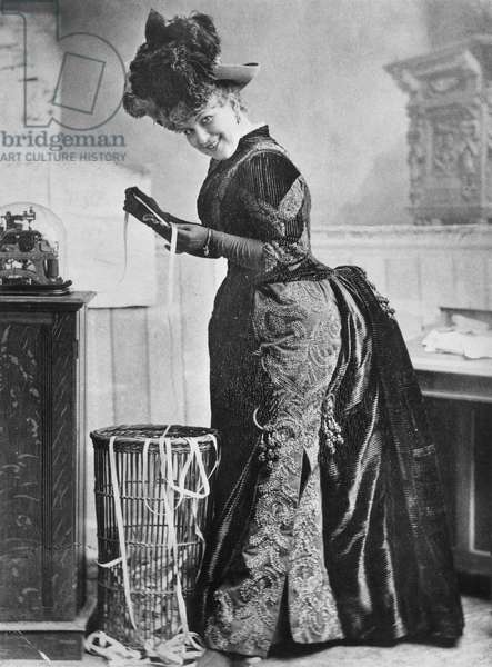 STOCK TICKER, 1890 American actress May Waldron in a scene from the play 'The Girl From Wall Street,' 1890.