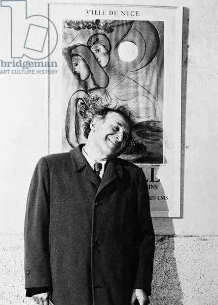 MARC CHAGALL (1887-1985) French (Russian-born) painter. Photographed in front of a French exhibition poster, c.1945 9b/w photo)