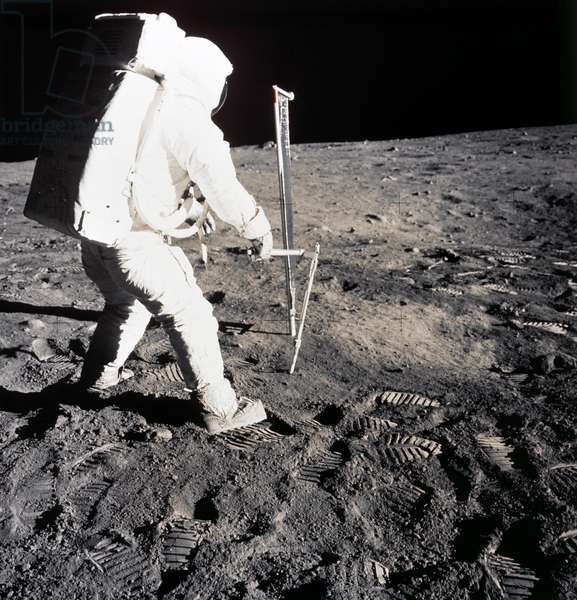 APOLLO 11 LANDING, 1969 Astronaut Edwin 'Buzz' Aldrin taking a soil sample from the surface of the moon. Photographed by Neil Armstrong, 1969.