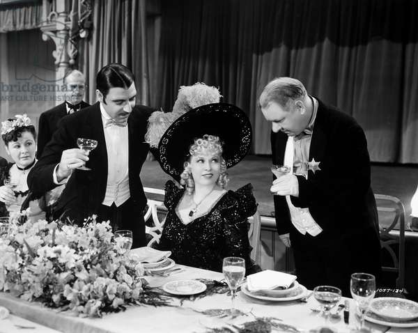 MY LITTLE CHICKADEE, 1940 Joseph Calleia, Mae West, and W.C. Fields in a scene from 'My Little Chickadee,' 1940.