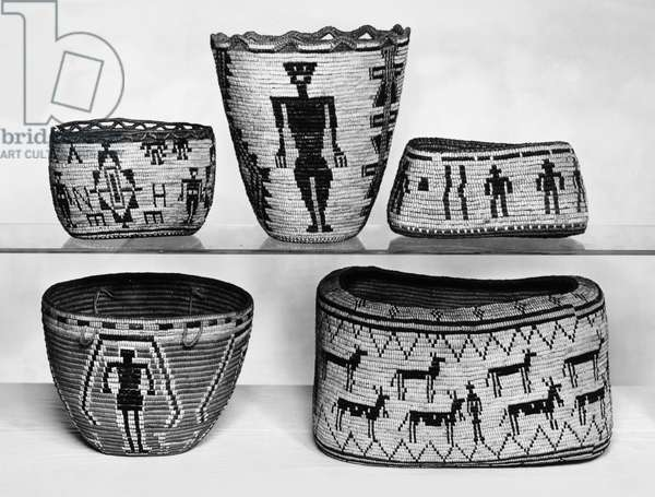 NATIVE AMERICAN BASKETS Various Native American woven baskets from California and the northwestern United States, collected by the artist Louis Comfort Tiffany (1848-1933). Photographed c.1946.