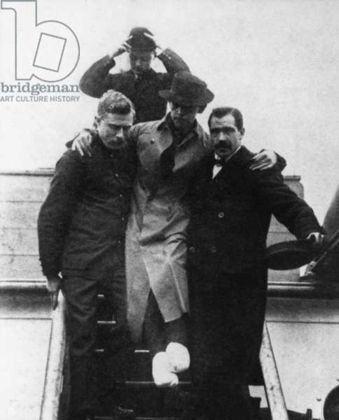 "TITANIC: HAROLD BRIDE With his feet crushed and frostbitten, second wireless operator of the ""Titanic"" leaves the ""Carpathia."""