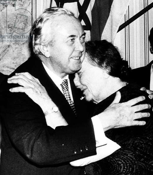 GOLDA MEIR (1898-1978) Israeli stateswoman. Meir embracing British Prime Minister Harold Wilson when he welcomed her as a guest of honor at a dinner given in London by the Labour Friends of Israel in 1974.