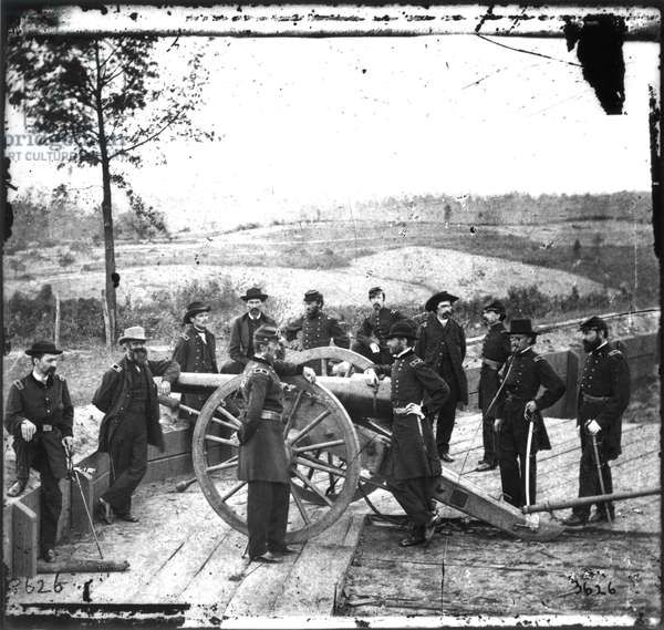 WILLIAM TECUMSEH SHERMAN (1820-1891). American army commander. General Sherman (right center, with his arm on the cannon's breach) with his staff at Federal Fort No. 7, Atlanta, in the autumn of 1864. Photograph by George N. Barnard.