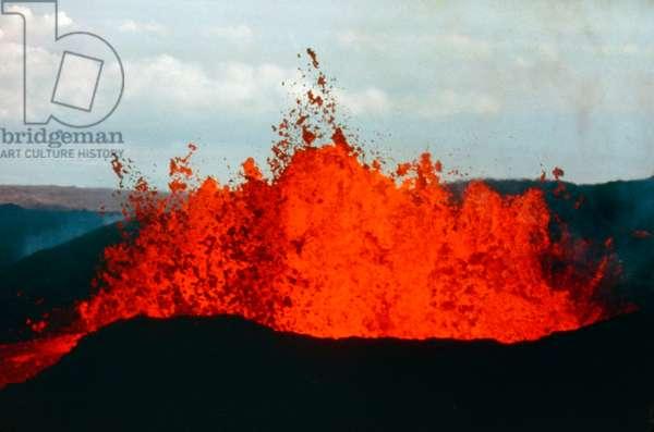 HAWAII: VOLCANOS, 1984 Lava splashing at Mauna Loa, during a dual eruption of the Mauna Loa and Kilauea volcanos on the island of Hawaii, 30 March 1984. Photograph by Bob Siebert.