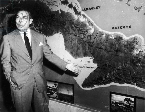 FULGENCIO BATISTA (1901-1973) Cuban soldier and dictator. Standing at a relief map of Cuba, Batista explains how government troops have isolated and contained the rebel forces of Fidel Castro, April 1958.