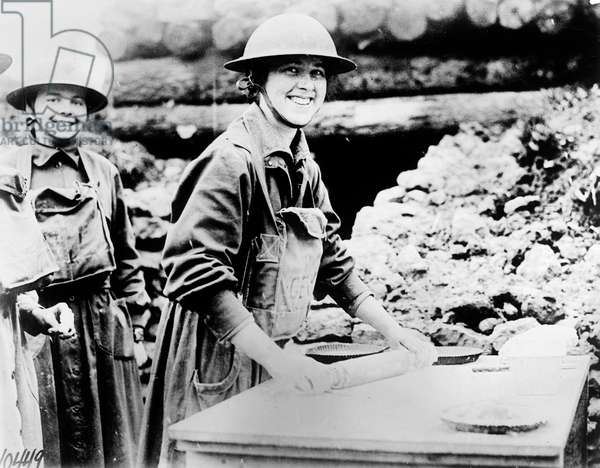 SALVATION ARMY, c.1920 'Salvation Army at the front.' Two women of the Salvation Army baking pies in a trench. Photograph, c.1920.