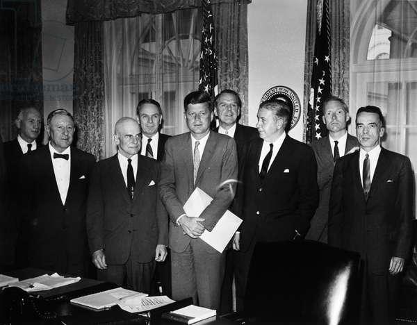 KENNEDY AND ADVISORS, 1961 U.S. President John F. Kennedy photographed with members of his Foreign Intelligence Advisory Board at the White House in Washington, D.C., 15 May 1961. Left to right: Gordon Gray; William Langer; Lt. Gen. James Doolittle; Gen. Maxwell Taylor; President Kennedy; Clark Clifford; James Killian Jr.; William Baker; J. Patrick Coyne.
